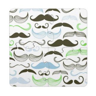 Diseño verde, azul y negro del bigote posavasos de puzzle