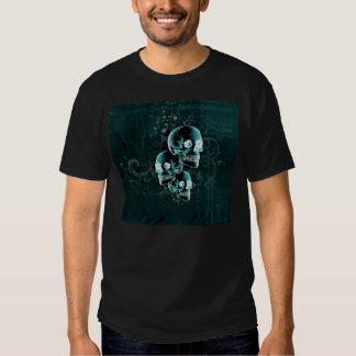 Diseño verde de los cráneos y de la voluta de la playeras
