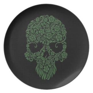 Diseño verde del cráneo de las flores y de las vid platos de comidas
