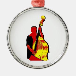 Diseño vertical de la imagen del bajista rojo y adorno navideño redondo de metal