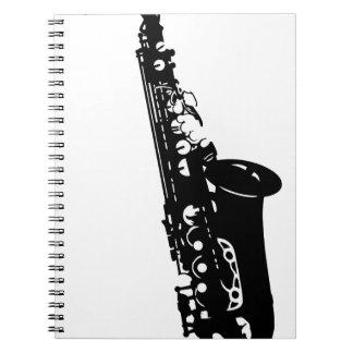 Diseños de los músicos del saxofón del instrumento libros de apuntes