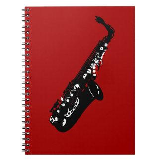 Diseños de los músicos del saxofón del instrumento note book