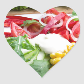 Dish from tomatoes, bell-pepper, mozzarella cheese heart sticker