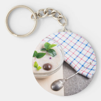 Dish of oatmeal in a bowl of glass keychain
