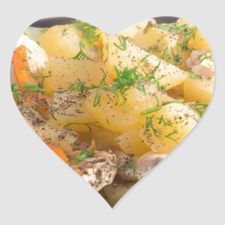 Dish of stewed potatoes with meat and spices heart sticker
