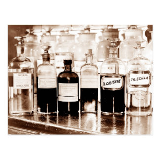 Display of apothecary bottles containing drugs postcard