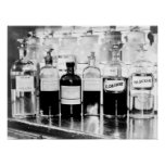 Display of apothecary bottles containing drugs posters