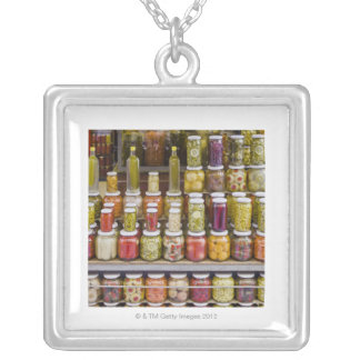 Display of pickled fruits and vegetables. silver plated necklace