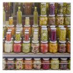 Display of pickled fruits and vegetables. tile
