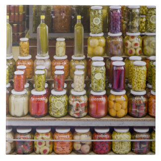 Display of pickled fruits and vegetables. tile