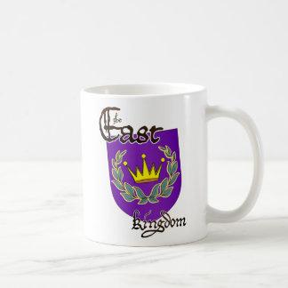 Dispositivo del este del reino con la taza del