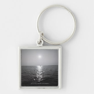 Distant boat on ocean keychain