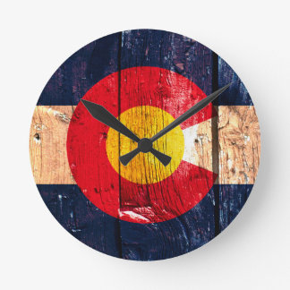 Distressed rustic wooden Colorado state flag Round Clock