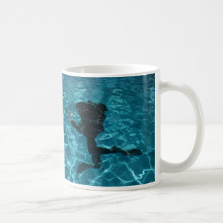 Diver moving underwater coffee mug