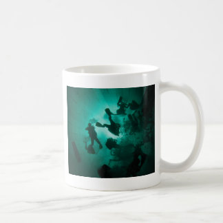 Divers in a tunnel coffee mugs