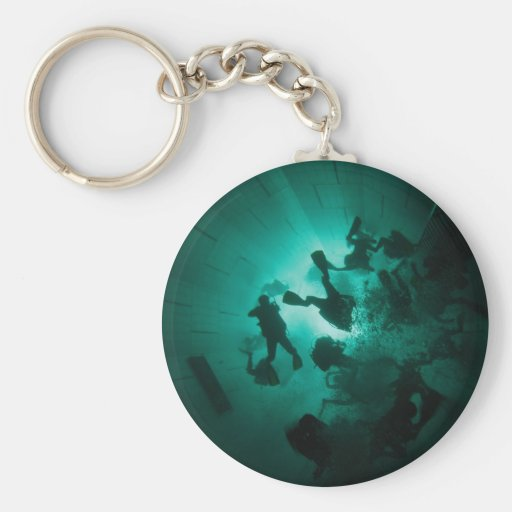 Divers in a tunnel key chain