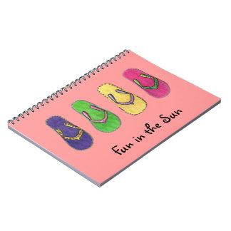 Diversión de las sandalias de la playa en los notebook