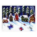 Diversión del invierno que hace ángeles de la niev tarjeta postal