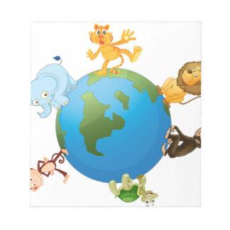 diversos animales en el globo de la tierra blocs de papel
