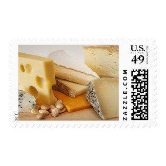 Diversos quesos en la tajadera timbres postales