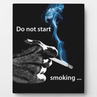 Do not start smoking ... plaque