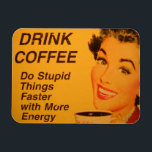 "Do Stupid Things Faster Magnet<br><div class=""desc"">Smiling woman with retro red lipstick and nails drinks her cup of morning coffee. The caption reads &quot;Drink Coffee - Do Stupid Things Faster with More Energy.&quot;</div>"