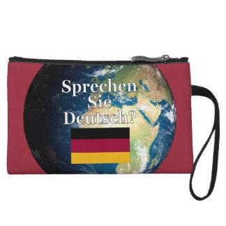 Do you speak German? in German. Flag & Earth Wristlet Purses