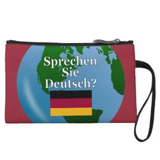 Do you speak German? in German. Flag & globe Wristlet Purses