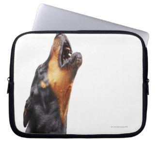 Doberman howling, close-up laptop computer sleeves