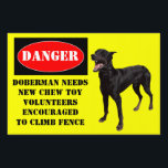 "Doberman Yard Sign<br><div class=""desc"">A funny twist on the beware of dog sign. Doberman needs new chew toy,  volunteers encouraged to climb fence.</div>"