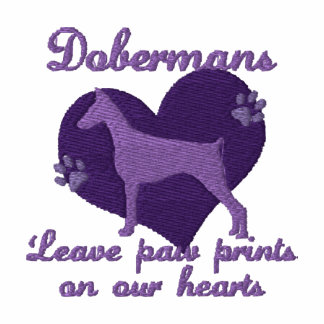 Dobermans Leave Paw Prints