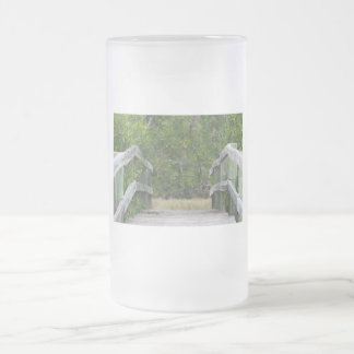 Dock leading into green mangrove stand frosted glass beer mug