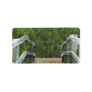 Dock leading into green mangrove stand address label