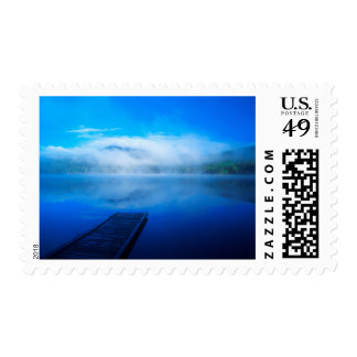 Dock on calm misty lake, California Postage