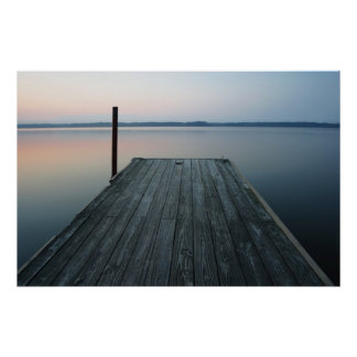 Dock over calm water at dawn poster