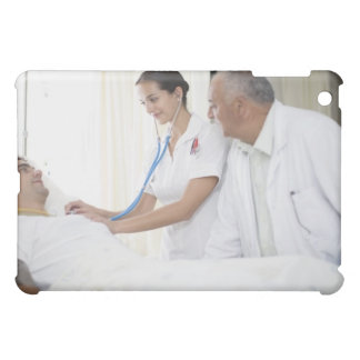 Doctor and nurse tending to patient iPad mini covers