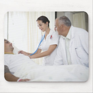 Doctor and nurse tending to patient mouse pad