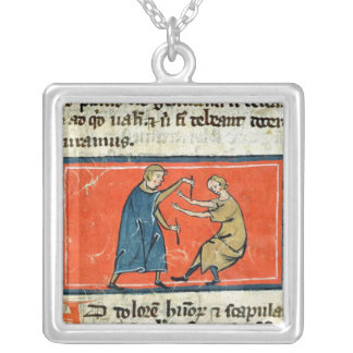 Doctor cauterising a wound with fire necklace