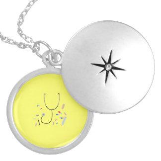 doctors equipment round locket necklace