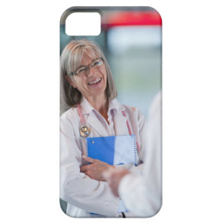 Doctors talking together in hospital hallway iPhone 5 cases