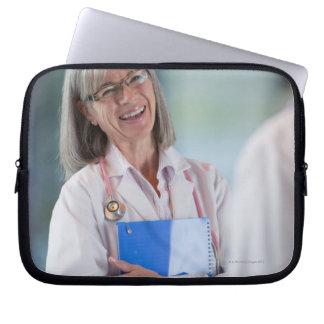 Doctors talking together in hospital hallway laptop computer sleeve