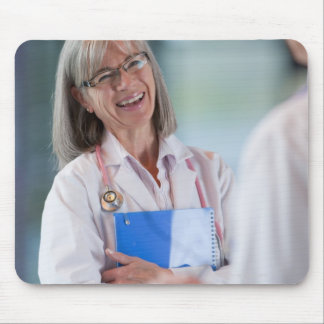 Doctors talking together in hospital hallway mouse pad
