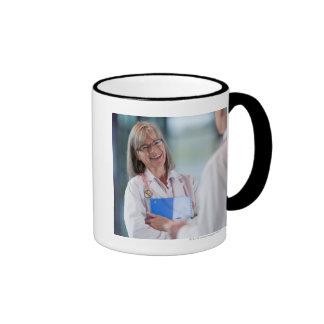 Doctors talking together in hospital hallway ringer coffee mug
