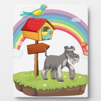Dog and birdhouse plaque