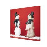 Dog and Snowman Canvas Print