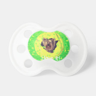 Dog breaks rules for tennis love pacifier