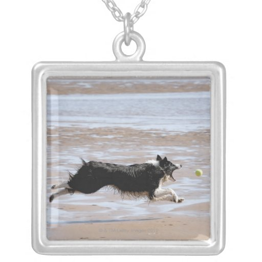 Dog chasing a ball at the beach square pendant necklace