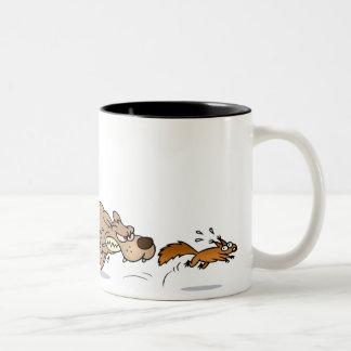 Dog chasing a squirrel coffee mug