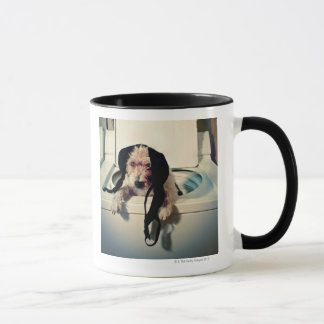 Dog helping out with the wash mug