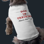 """Dog In Training - Dog T-shirt<br><div class=""""desc"""">A simple t-shirt for your dog to show that he/she is in training and that people should not pet. &quot;Dog In Training&quot; in big red letters and &quot;Please don&#39;t pet&quot; in black below.</div>"""